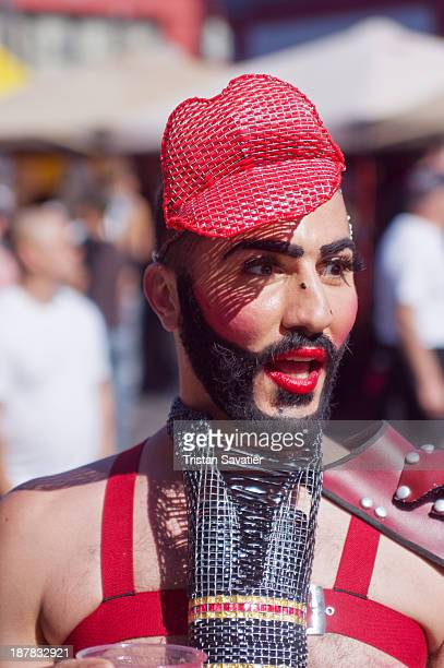 CONTENT] Man with red lipstick and red lips headpiece at the Folsom Street fair The Folsom Street Fair is an annual BDSM and leather subculture...