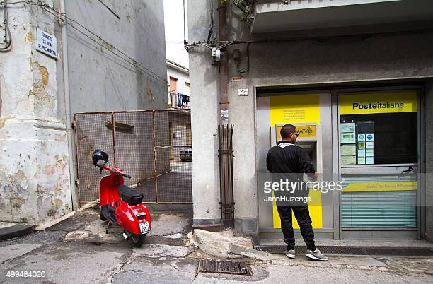 Man with Red Vestpa at ATM Outside Post Office, Sicily