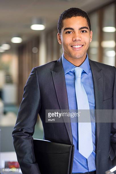 man with resume under his arm arrives for  interview - businesswear stock pictures, royalty-free photos & images