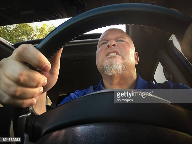 Man with road rage driving