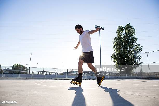 man with rollerblades skating - inline skate stock photos and pictures