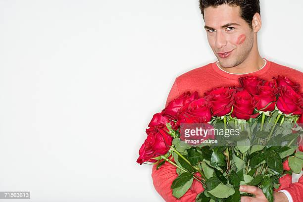 man with roses and lipstick kiss - naughty valentine stockfoto's en -beelden