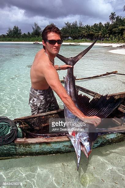 Man with Sailfish in Canoe