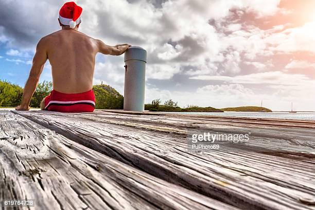 Man with Santa Hat in Bahamas