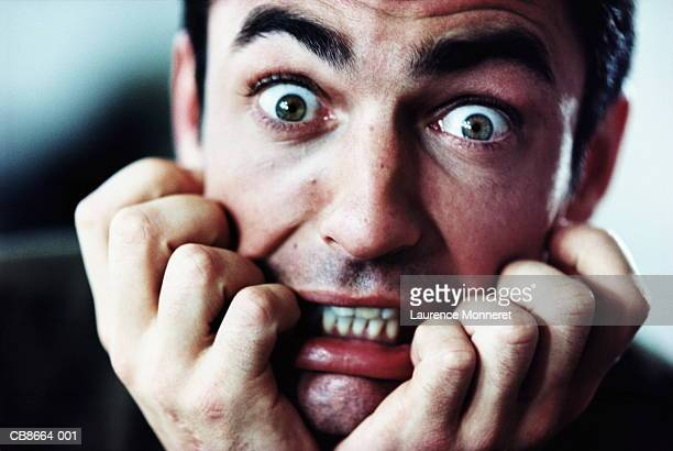 man with scared expression, close-up - terrified stock pictures, royalty-free photos & images