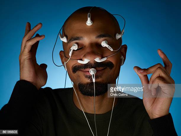 Man with sensors on face.