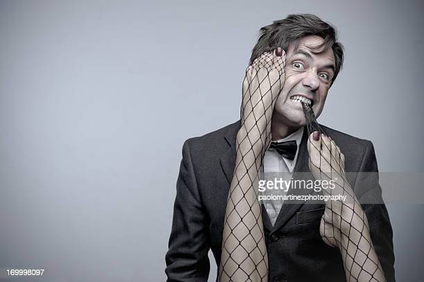 man with sexy feet in the face. - male feet on face stock photos and pictures