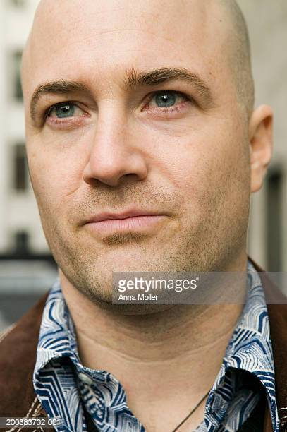 Man with shaved head, close-up