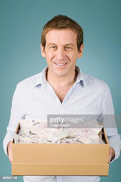 Man with shoebox of money