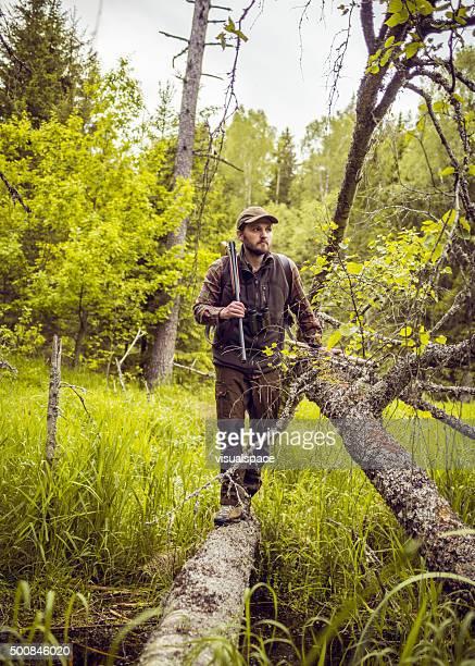 Man With Shotgun Crossing Over Bog
