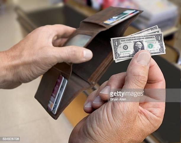 Man with Shrunken Dollar Bills
