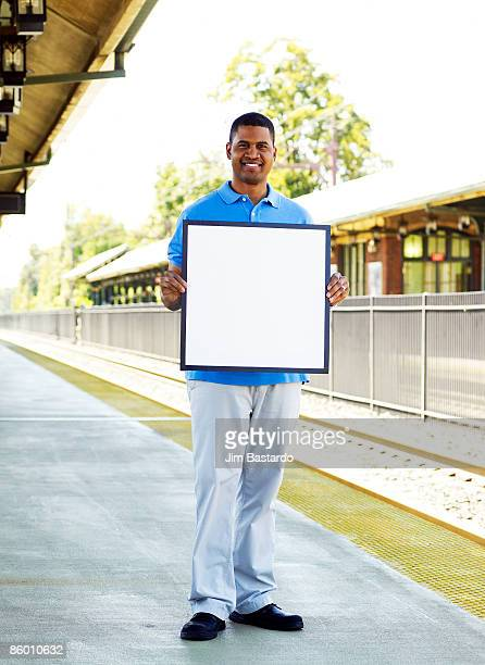 man with sign in town - blank sign stock photos and pictures
