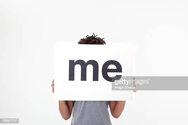 man with sign that says me - identity stock photos and pictures