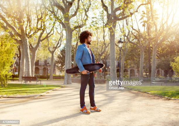 man with skateboard at the park - one young man only stock pictures, royalty-free photos & images