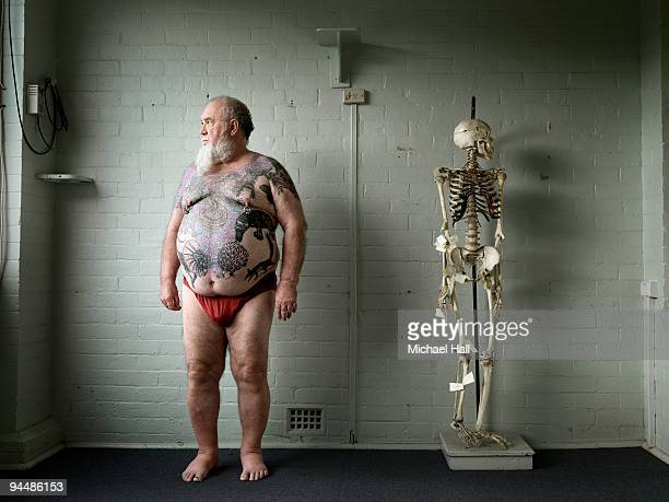 man with skeleton - fat bald men stock pictures, royalty-free photos & images