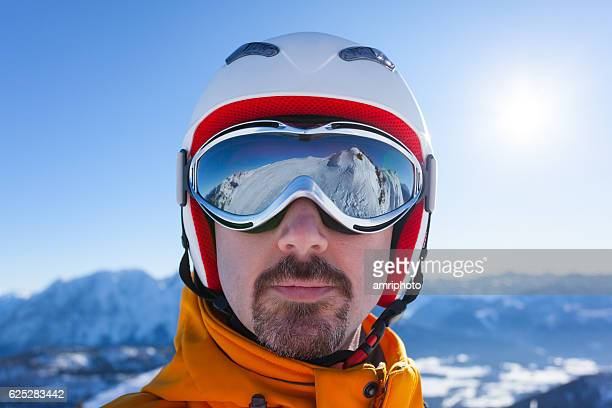 man with skiing goggles and reflections