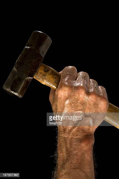 Man with sledgehammer. Dirty, greasy. Working class. Hand.