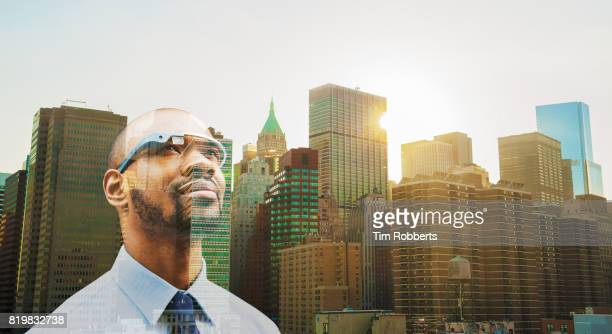 Man with smart glasses and buildings