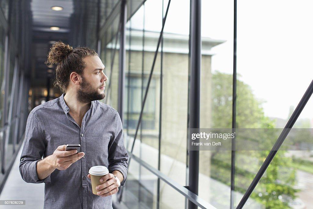 Man with smartphone on coffee break : Stock Photo