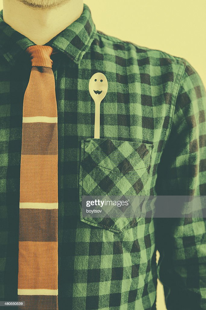 Man with smiling spoon in the pocket in retro style : Stock Photo