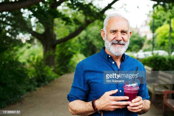 man with smoothie looking at camera - only men stock pictures, royalty-free photos & images