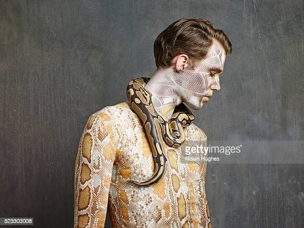 man with snake makeup and snake - ヘビ柄 ストックフォトと画像