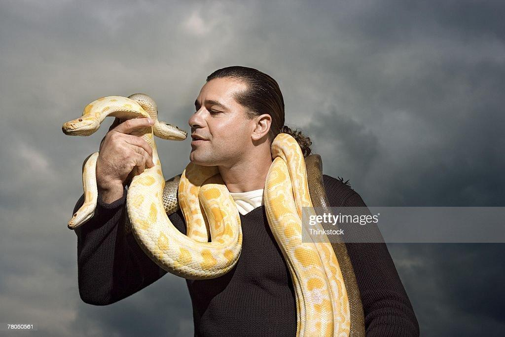 Man with snakes around neck : Stock Photo
