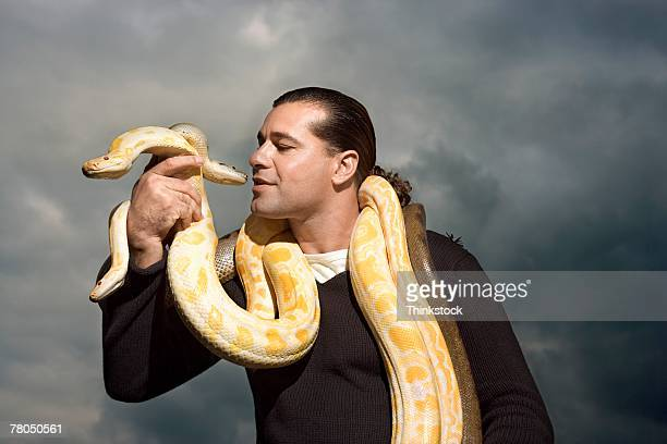 Man with snakes around neck