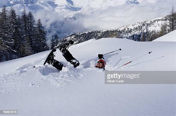 man with snowshoes in snow - achteloos stockfoto's en -beelden
