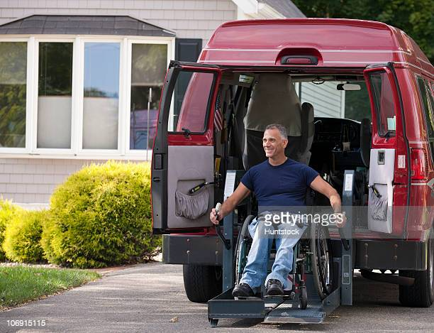 Man with spinal cord injury in a wheelchair getting in his accessible van