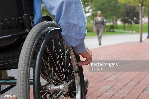 Man with spinal cord injury in a wheelchair on a street