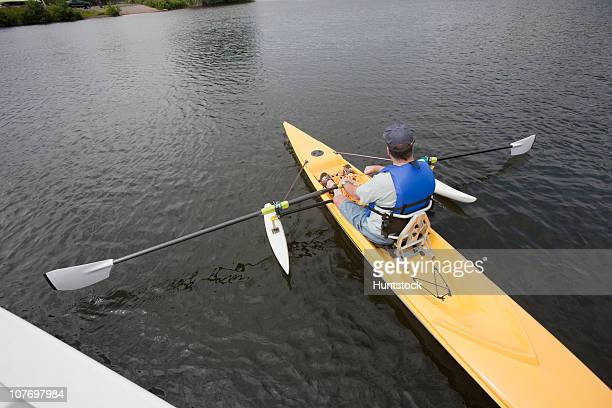 man with spinal cord injury sitting in accessible boat - 障害者スポーツ ストックフォトと画像