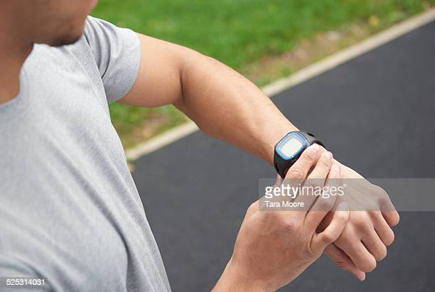 man with sports digital watch