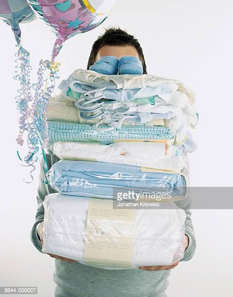 Man with Stack of Clothing