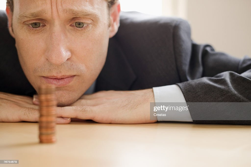 Man with stack of coins : Stock Photo