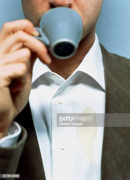 Man with Stain on His Shirt Drinking Coffee