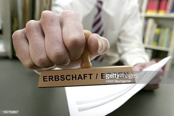 GERMANY BONN Man with stamp and the writing Erbschaft Erben