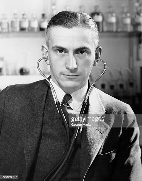 man with stethoscope on his head - 20th century stock pictures, royalty-free photos & images