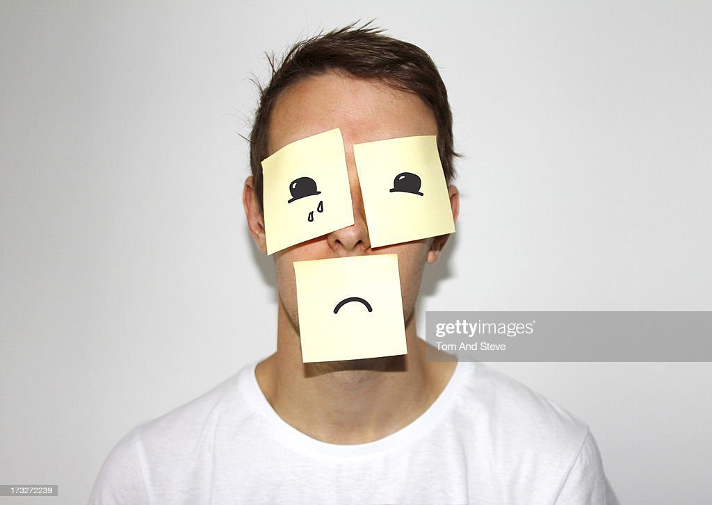 Man with sticky memo notes on his face : Stock Photo