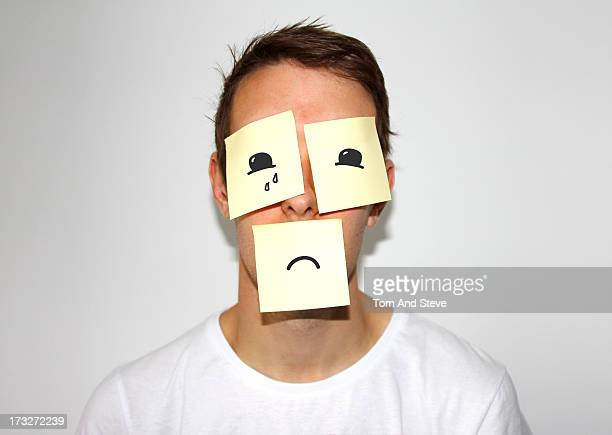 Man with sticky memo notes on his face