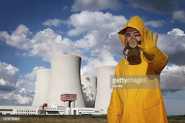 Man With 'Stop' Gesture in Front of Nuclear Reactor