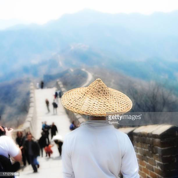 Man with straw hat on Chinese Wall