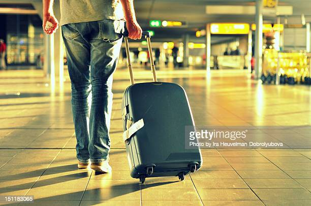Man with suitcase walking