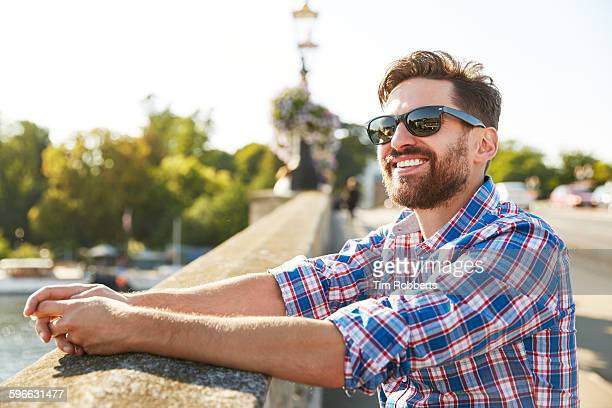 man with sunglasses on bridge. - sunglasses stock pictures, royalty-free photos & images