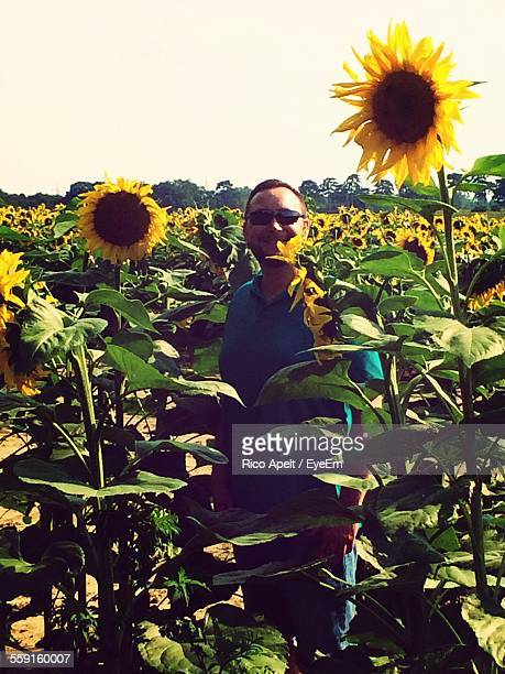 Man With Sunglasses Standing Amidst Sunflower Field