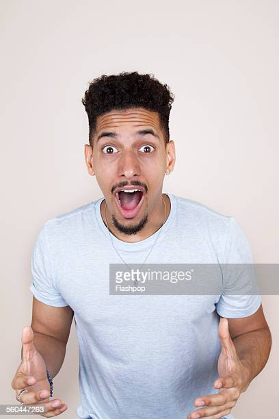 man with surprised expression - opwinding stockfoto's en -beelden