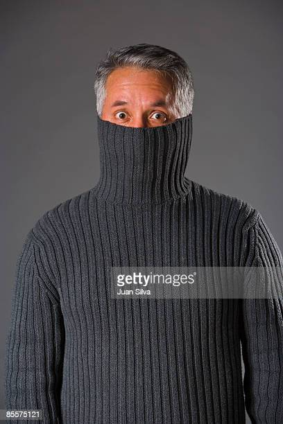Man with sweater pulled up to eyes, portrait