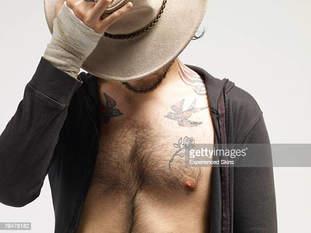 man with sweater unzipped and a hat - hairy chest stock photos and pictures