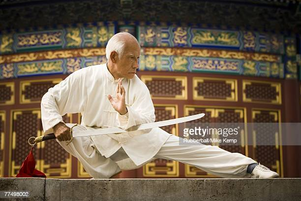 Man with sword doing Kung Fu