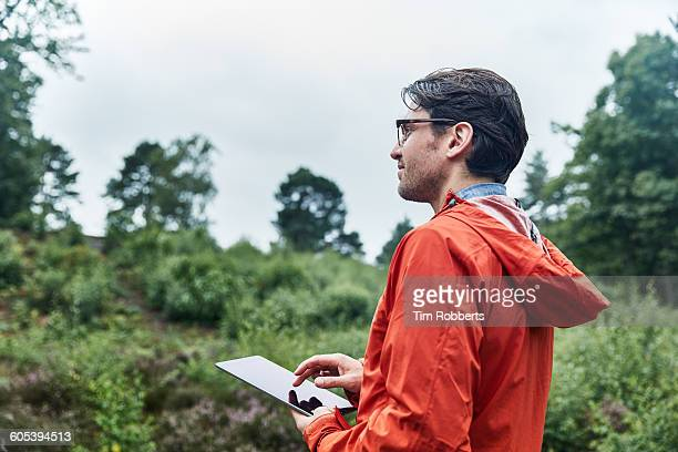man with tablet in green environment. - botanist stock pictures, royalty-free photos & images